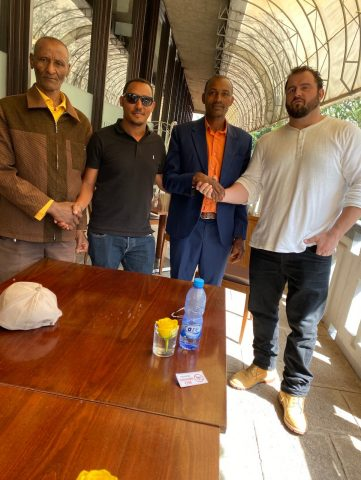 Royal Coffee CEO and Ethiopia Representative Max Nicholas-Fulmer and Haile Andualem making secondary payments to Desta Gola and Adisu Kidane in Addis Ababa, Ethiopia, 2019.